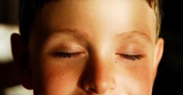 boy-closing-eyes