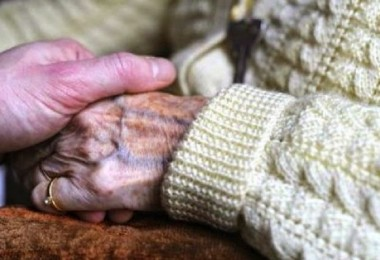 A-woman-suffering-from-Alzheimers-desease-holds-the-hand-of-a-relative-in-a-retirement-house-in-Angervilliers-eastern-France-via-AFP-e1347867744614