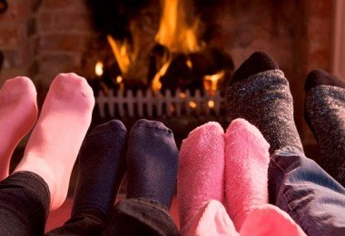 bigstock-Families-Of-Feet-Warming-At-A-4135281