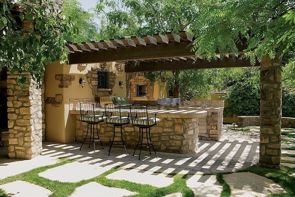 25 ideas de dise os r sticos para decorar el patio for Cocinas para jardin