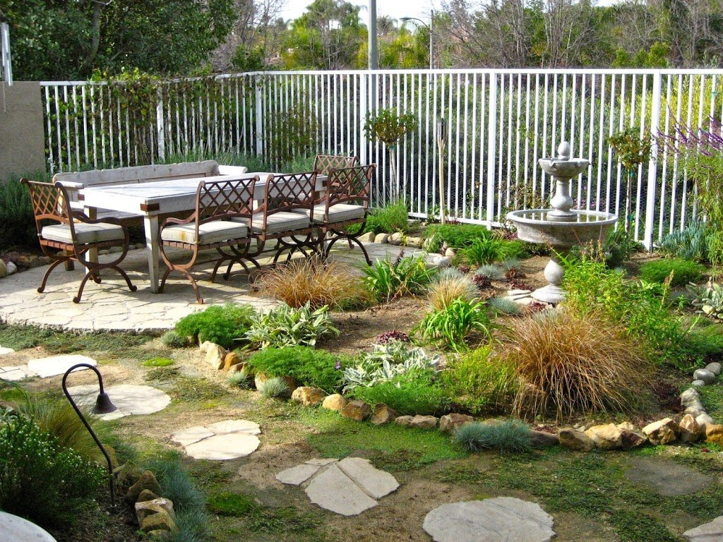 25 ideas de dise os r sticos para decorar el patio - Fuentes de patio ...