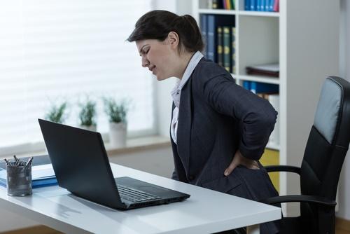 dolor en la espalda baja oficina