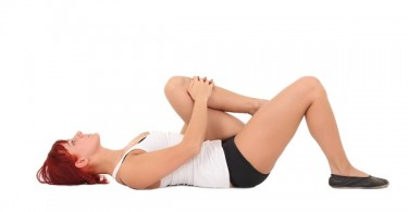 Estiramientos de rodilla a pecho