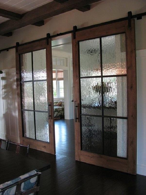 25 ideas de puertas interiores para el hogar for Disenos de puertas en madera y vidrio