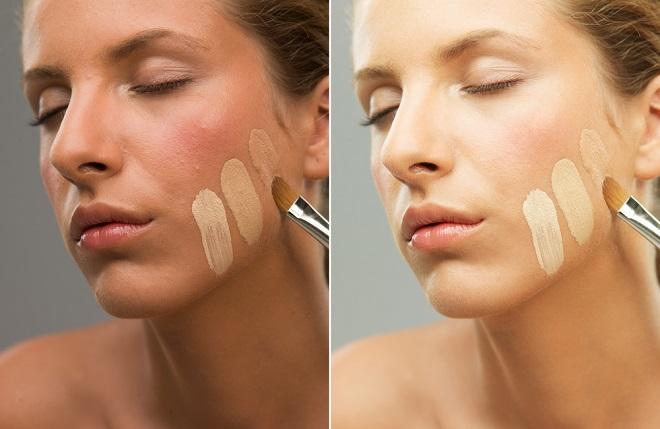 Mujer aplicando la base de maquillaje para el rostro