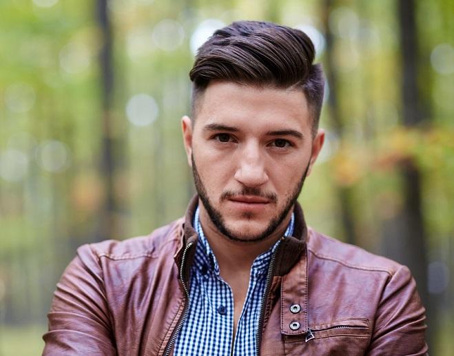 Hombre joven usando barba corta y cuidada