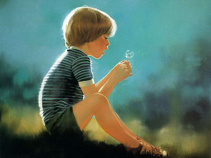 Niño jugando con una flor y la ley de atracción