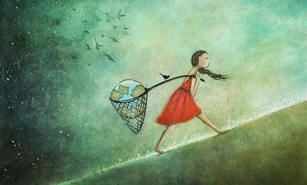 Mujer lleva el mundo en sus manos con la ley de atracción