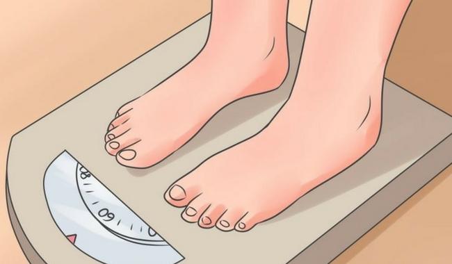 usando la balanza para saber el peso