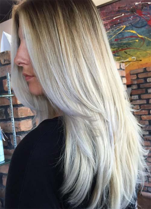 Mujer joven luciendo un corte de pelo largo en capas sobre los hombros