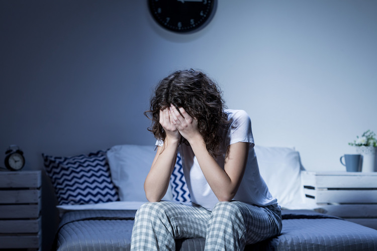 Persona con problemas para conciliar el sueño