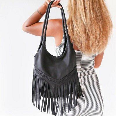 tendencias de moda bolsos con flequillo
